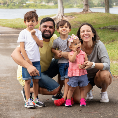 A family in the park with their child with Dravet syndrome
